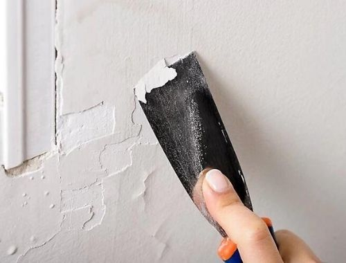 como arreglar una pared desconchada